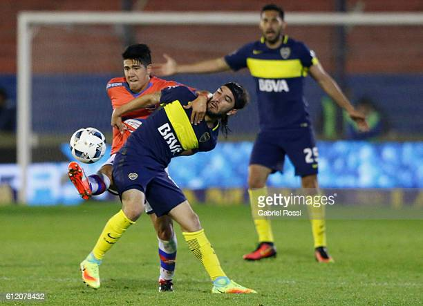 Sebastian Perez Cardona of Boca Juniors fights for the ball with Diego Morales of Tigre during a match between Tigre and Boca Juniors as part of...