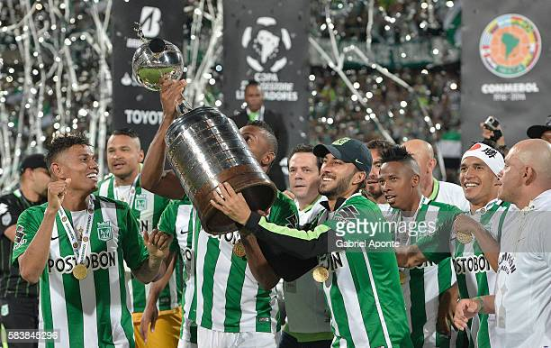 Sebastian Perez of Atletico Nacional lifts the trophy after a second leg final match between Atletico Nacional and Independiente del Valle as part of...