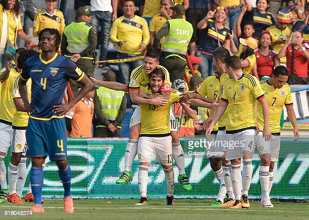 Sebastian Perez of Colombia celebrates with James Rodriguez after scoring the secong goal of his team during a match between Colombia and Ecuador as...