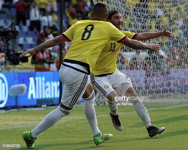 Sebastian Perez of Colombia celebrates with teammate Edwin Cardona after scoring the second goal of his team during a match between Colombia and...