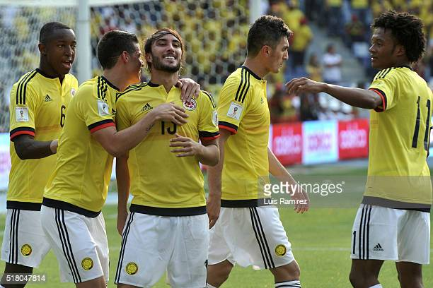 Sebastian Perez of Colombia celebrates with teammates after scoring the second goal of his team during a match between Colombia and Ecuador as part...