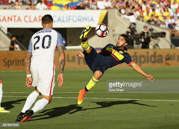 Sebastian Perez of Colombia controls the ball in front of Geoff Cameron of United States during the 2016 Copa America Centenario Group match between...