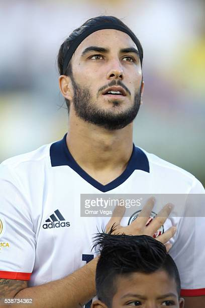 Sebastian Perez of Colombia sings the Colombian National Anthem prior a group A match between Colombia and Paraguay at Rose Bowl Stadium as part of...