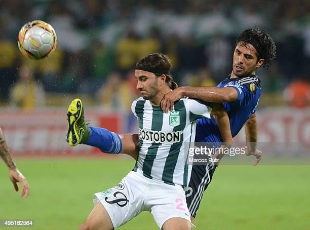Sebastian Perez of Nacional fights for the ball with Fabian Vargas of Millonarios during a match between Atletico Nacional and Millonarios as part of...