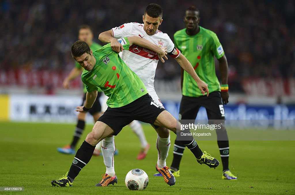 Sebastian Pocognoli of Hannover is challenged by <a gi-track='captionPersonalityLinkClicked' href=/galleries/search?phrase=Vedad+Ibisevic&family=editorial&specificpeople=535857 ng-click='$event.stopPropagation()'>Vedad Ibisevic</a> of Stuttgart during the Bundesliga match between VfB Stuttgart and Hannover 96 at Mercedes-Benz Arena on December 7, 2013 in Stuttgart, Germany.