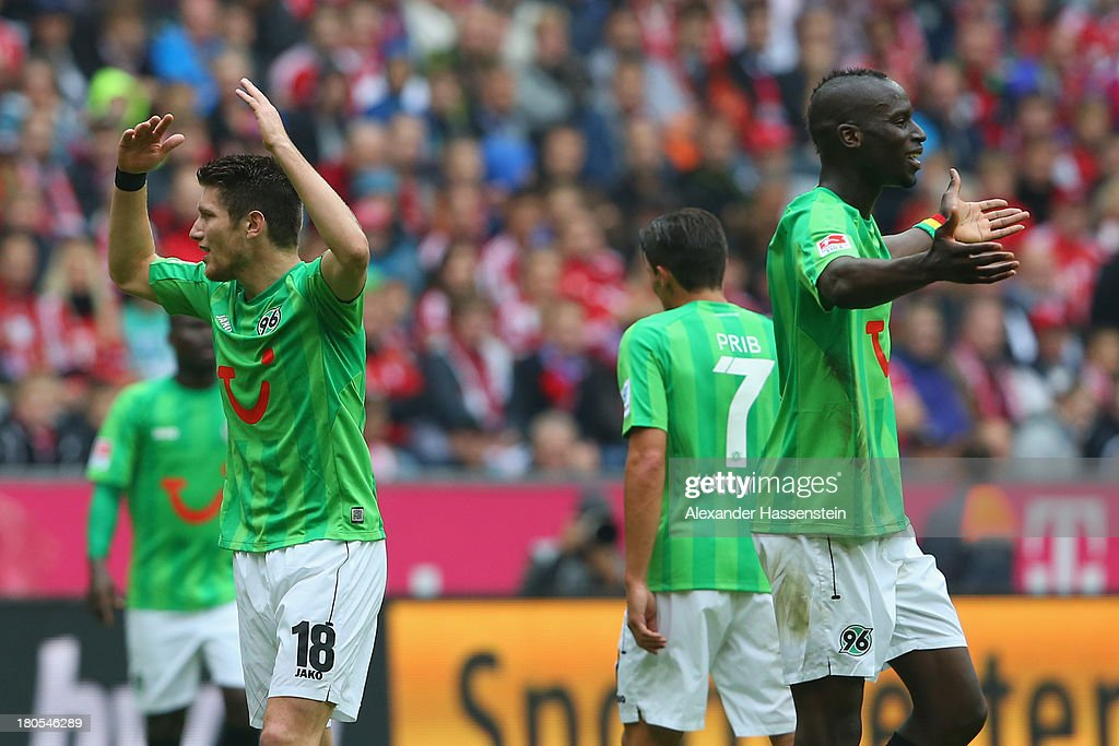 Sebastian Pocognoli (L) of Hannover reacts with his team mate Salif Sane (R) during the Bundesliga match between FC Bayern Muenchen and Hannover 96 at Allianz Arena on September 14, 2013 in Munich, Germany.