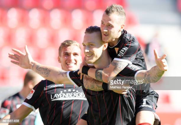 Sebastian Polter and Marcel Hartel of 1 FC Union Berlin celebrate after scoring the 01 during the Second Bundesliga match between Jahn Regensburg and...