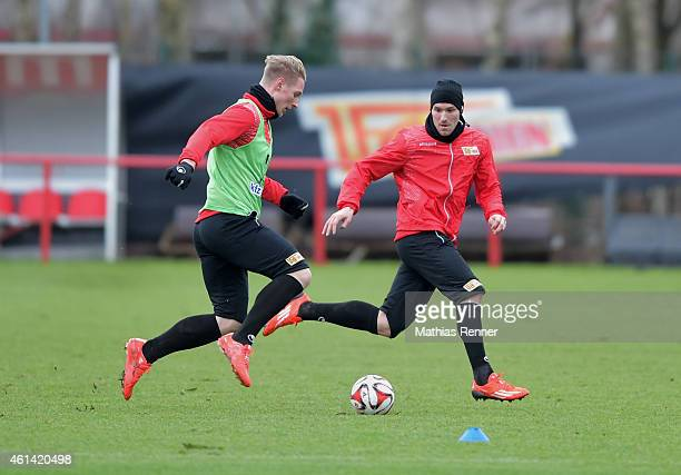 Sebastian Polter handles the ball against Mario Eggimann of 1 FC Union Berlin during the training of Union Berlin on january 12 2015 in Berlin Germany