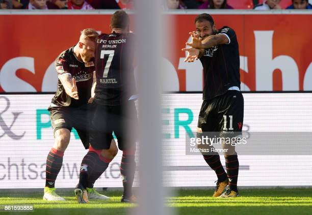 Sebastian Polter Marcel Hartel and Akaki Gogia of 1 FC Union Berlin celebrate after scoring the 02 during the game between Jahn Regensburg and Union...