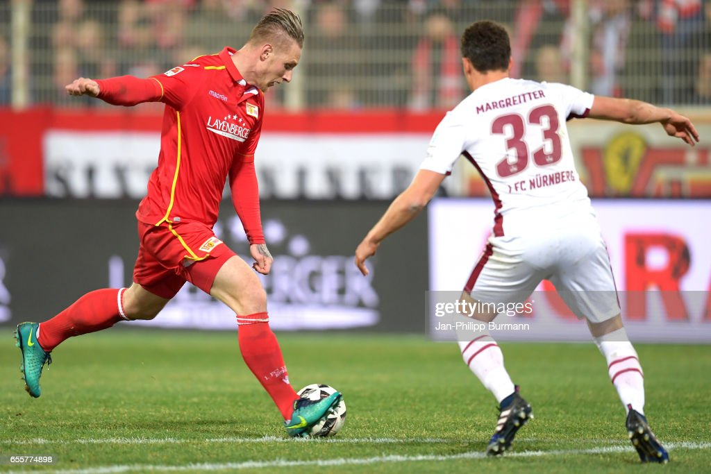 Sebastian Polter of 1.FC Union Berlin and Georg Margreitter of 1. FC Nuernberg during the game between 1 FC Union Berlin and 1 FC Nuernberg on March 20, 2017 in Berlin, Germany.