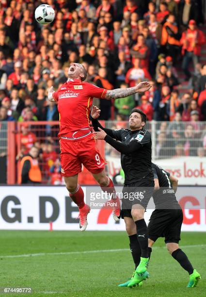 Sebastian Polter of 1FC Union Berlin Tim Kister and Marco Thiede of SV Sandhausen during the game between dem 1 FC Union Berlin and dem SV Sandhausen...