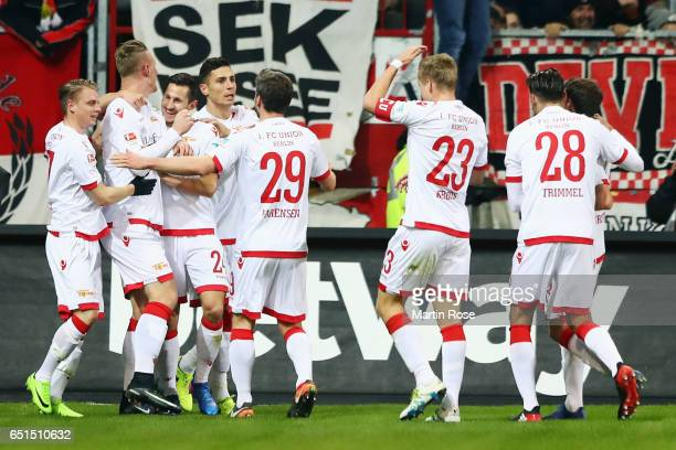 Sebastian Polter of Berlin celebrates his team's first goal with team mates during the Second Bundesliga match between FC St Pauli and 1 FC Union...
