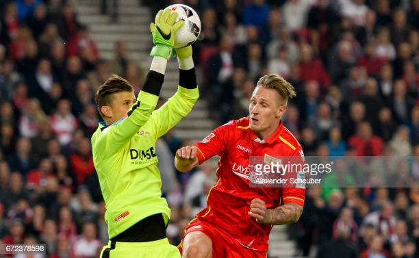 Sebastian Polter of Berlin challenges Mitchell Langerak of Stuttgart during the Second Bundesliga match between VfB Stuttgart and 1 FC Union Berlin...