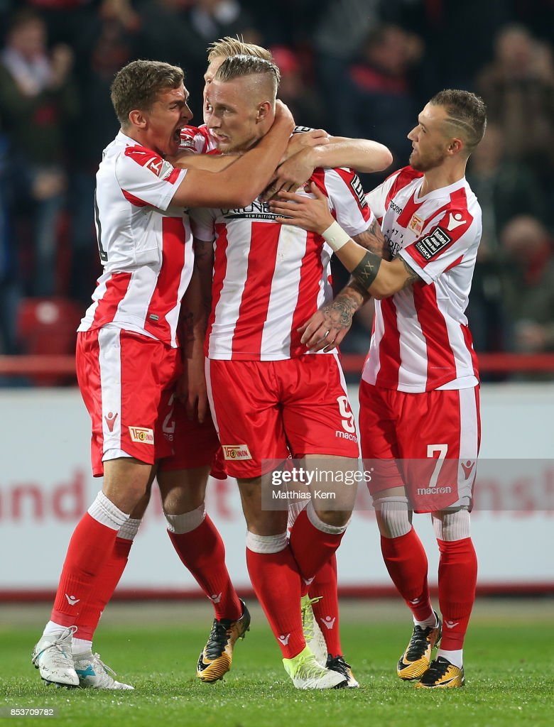 Sebastian Polter (C) of Berlin jubilates with team mates after scoring the first goal during the Second Bundesliga match between 1. FC Union Berlin and 1. FC Kaiserslautern at Stadion An der Alten Foersterei on September 25, 2017 in Berlin, Germany.