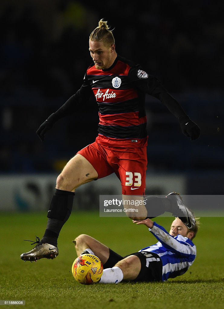 Sebastian Polter of Queens Park Rangers skips over the tackle of Barry Bannan of Sheffield Wednesday during the Sky Bet Championship match between Sheffield Wednesday and Queens Park Rangers at Hillsborough on February 23, 2016 in Sheffield, United Kingdom.