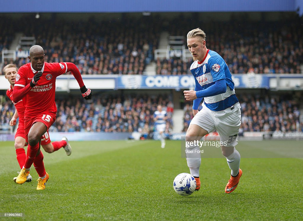 Sebastian Polter of Queens Park Rangers takes on Rod Fanni of Charlton Athletic during the Queens Park Rangers v Charlton Athletic Sky Bet...