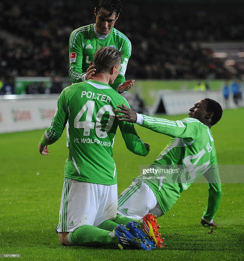 Sebastian Polter of Wolfsburg celebrates scoring his goal with Giovanni Sio and <a gi-track='captionPersonalityLinkClicked' href=/galleries/search?phrase=Christian+Traesch&family=editorial&specificpeople=5482851 ng-click='$event.stopPropagation()'>Christian Traesch</a> during the Bundesliga match between VfL Wolfsburg and 1. FC Koeln at Volkswagen Arena on January 21, 2012 in Wolfsburg, Germany.