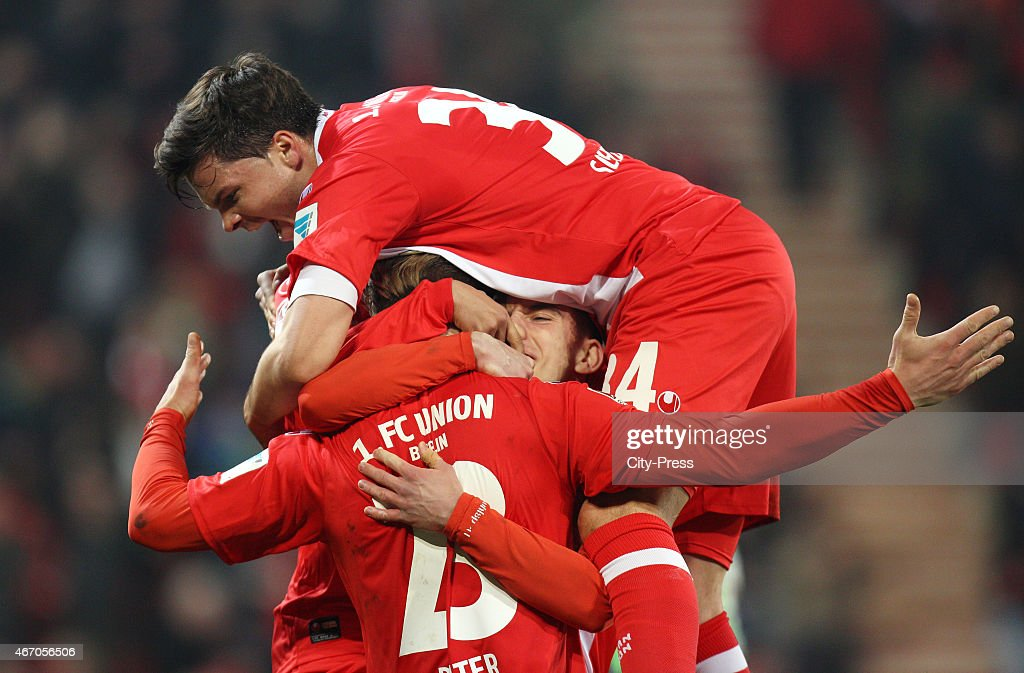 Sebastian Polter Valmir Sulejmani and Fabian Schoenheim of 1 FC Union Berlin celebrate after scoring the 10 during the match between Union Berlin and...