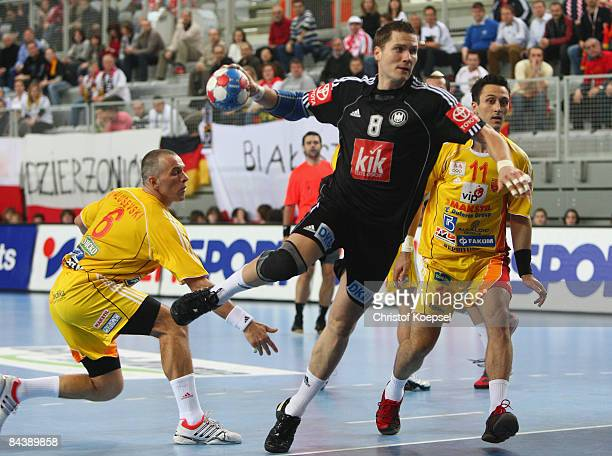 Sebastian Preiss of Germany scores a goal during the Men's World Handball Championships match between Macedonia and Germany at the Sports Centre...