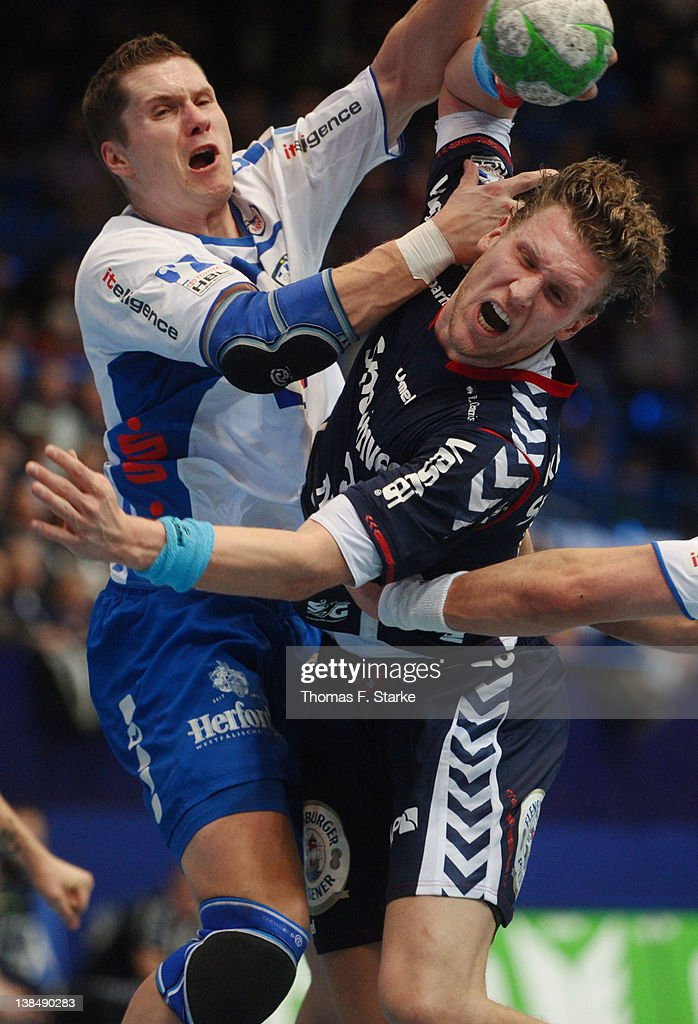 <a gi-track='captionPersonalityLinkClicked' href=/galleries/search?phrase=Sebastian+Preiss&family=editorial&specificpeople=579025 ng-click='$event.stopPropagation()'>Sebastian Preiss</a> (L) of Lemgo tackles <a gi-track='captionPersonalityLinkClicked' href=/galleries/search?phrase=Lars+Kaufmann&family=editorial&specificpeople=579003 ng-click='$event.stopPropagation()'>Lars Kaufmann</a> of Flensburg during the Handball Bundesliga match between TBV Lemgo and SG Flensburg-Handewitt at the Lipperland Hall on February 7, 2012 in Lemgo, Germany.