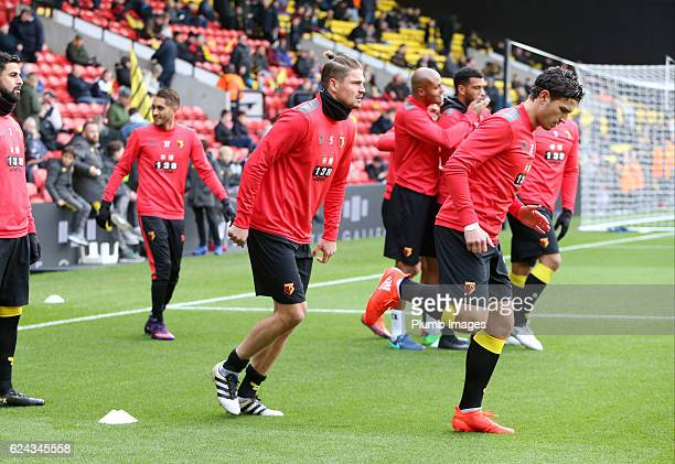 Sebastian Prodl and Daryl Janmaat of Watford warm up at Vicarage Road ahead of the Premier League match between Watford and Leicester City at...
