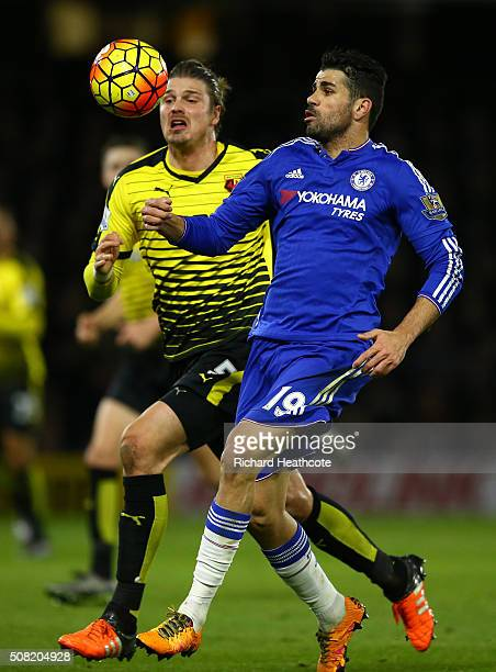 Sebastian Prodl of Watford and Diego Costa of Chelsea compete for the ball during the Barclays Premier League match between Watford and Chelsea at...