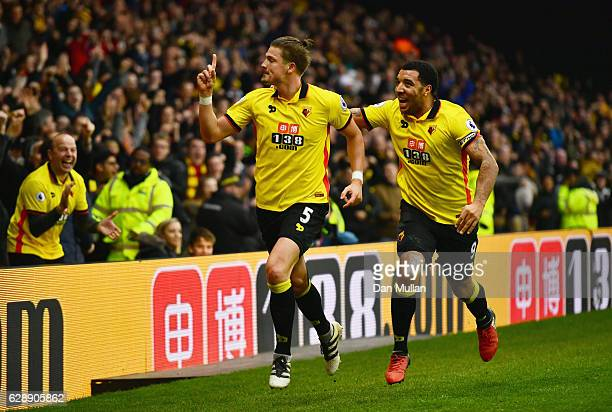 Sebastian Prodl of Watford celebrates with Troy Deeney as he scores their second goal during the Premier League match between Watford and Everton at...