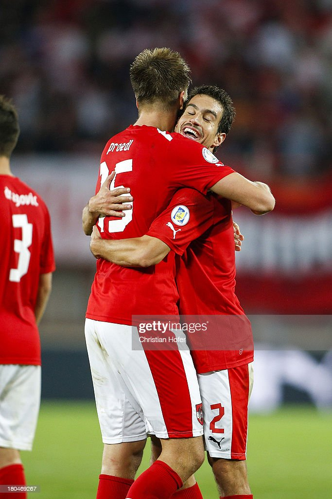 Sebastian Proedl (L) and Gyoergy Garics of Austria celebrate after winning the FIFA World Cup 2014 Group C qualification match between Austria and the Republic of Ireland at the Ernst Happel Stadium on September 10, 2013 in Vienna, Austria.