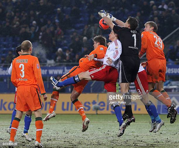 Sebastian Proedl and Per Mertesacker of Bremen and Frank Rost and Marcell Jansen and David Rozehnal of Hamburg battle for the ball during the...