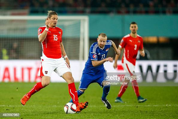 Sebastian Proedl of Austria competes for the ball with Martin Buechel of Liechtenstein during the UEFA EURO 2016 Qualifier between Austria and...