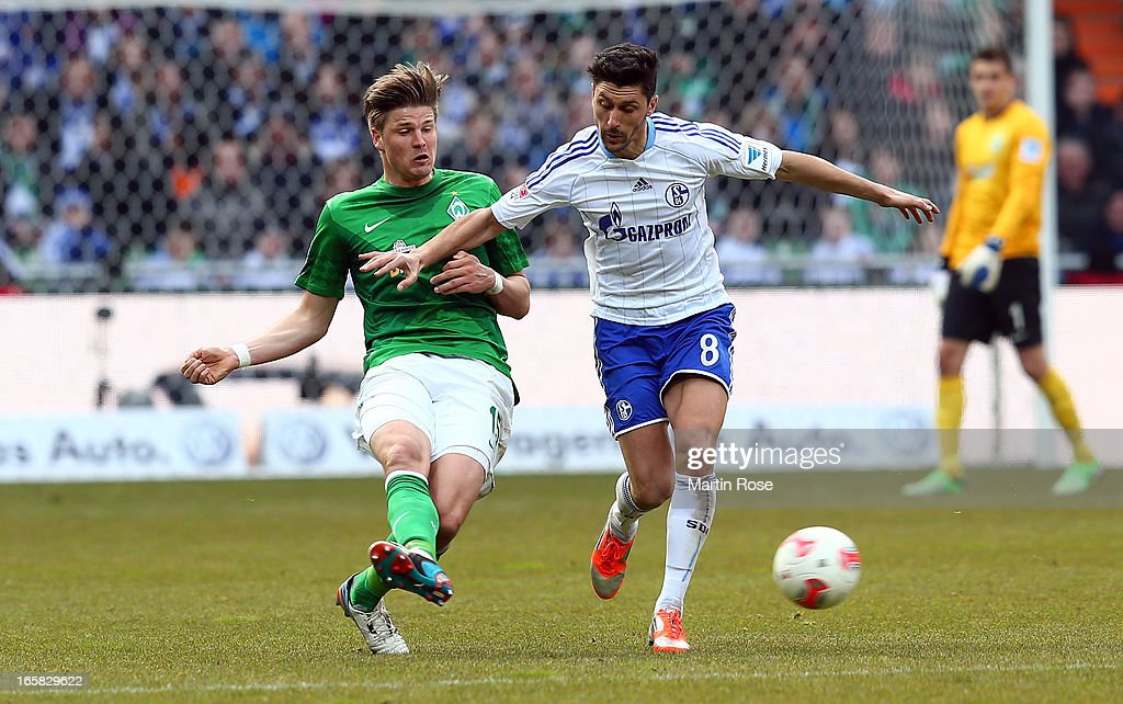 Sebastian Proedl (L) of Bremen and Ciprian Marica (R) of Schalke battle for the ball during the Bundesliga match between Werder Bremen and FC Schalke 04 at Weser Stadium on April 6, 2013 in Bremen, Germany.