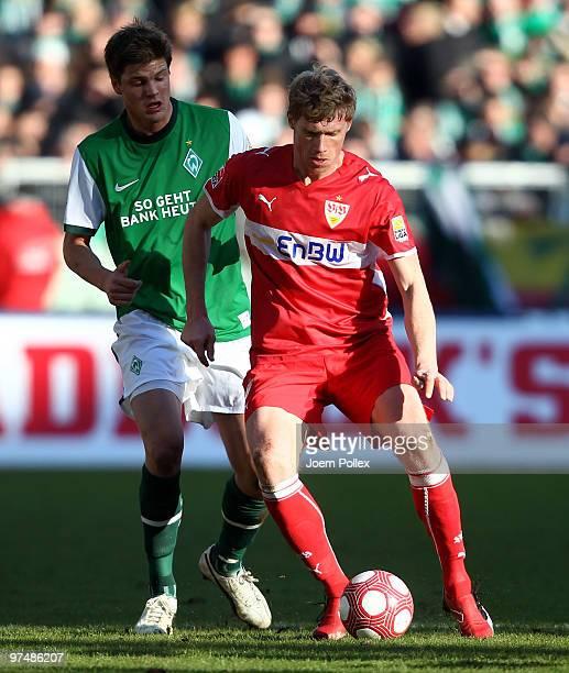 Sebastian Proedl of Bremen and Pavel Pogrebnyak of Stuttgart compete for the ball during the Bundesliga match between Werder Bremen and VfB Stuttgart...