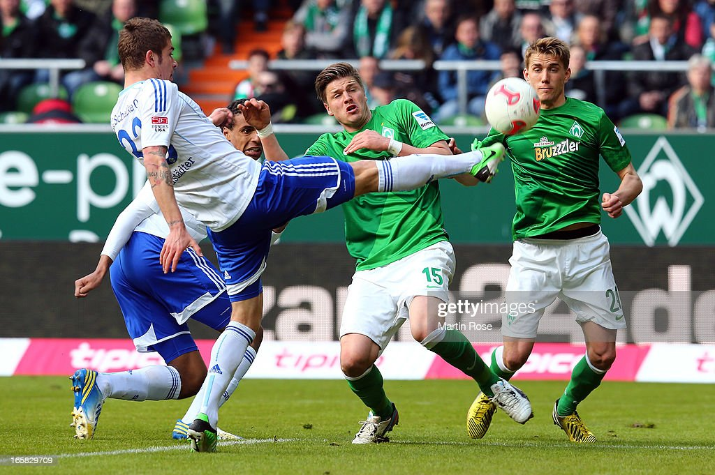 Sebastian Proedl (#15) of Bremen and Sead Kolasinac (L) of Schalke battle for the ball during the Bundesliga match between Werder Bremen and FC Schalke 04 at Weser Stadium on April 6, 2013 in Bremen, Germany.