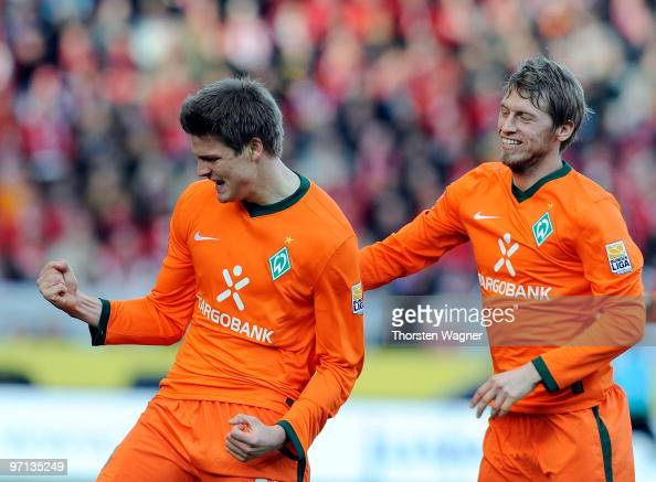 Sebastian Proedl of Bremen celebrates after scoring the 21 with his team mate Aaron Hunt during the Bundesliga match between FSV Mainz 05 and SV...
