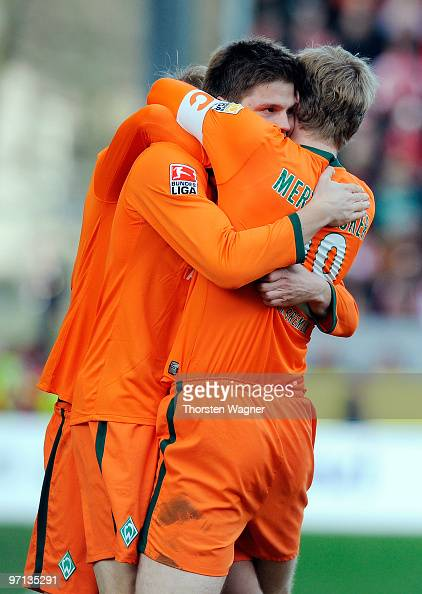 Sebastian Proedl of Bremen celebrates after scoring the 21 with his team mates Per Mertesacker and Aaron Hunt during the Bundesliga match between FSV...