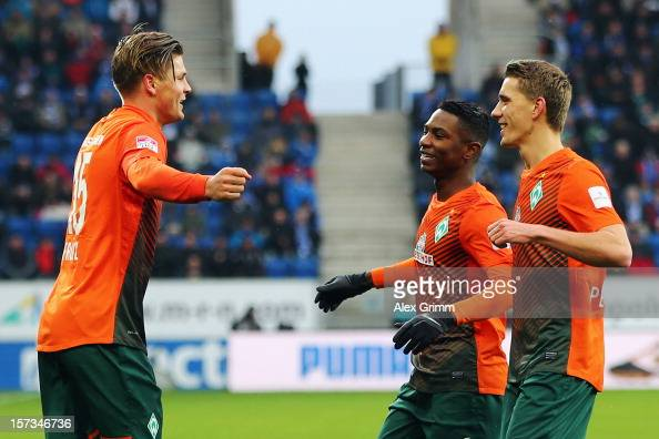 Sebastian Proedl of Bremen celebrates his team's first goal with team mates Eljero Elia and Nils Petersen during the Bundesliga match between TSG...