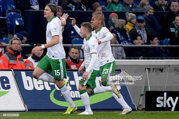 Sebastian Proedl of Bremen celebrates with team mates after scoring his team's first goal during the Bundesliga match between FC Schalke 04 and SV...