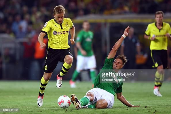 Sebastian Proedl of Bremen challenges Jakub Blaszczykowski of Dortmund during the Bundesliga match between Borussia Dortmund and Werder Bremen at...