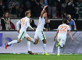 Sebastian Proedl of Werder Bremen celebrates with Nils Petersen and Fin Bartels as he scores their third goal during the Bundesliga match between...