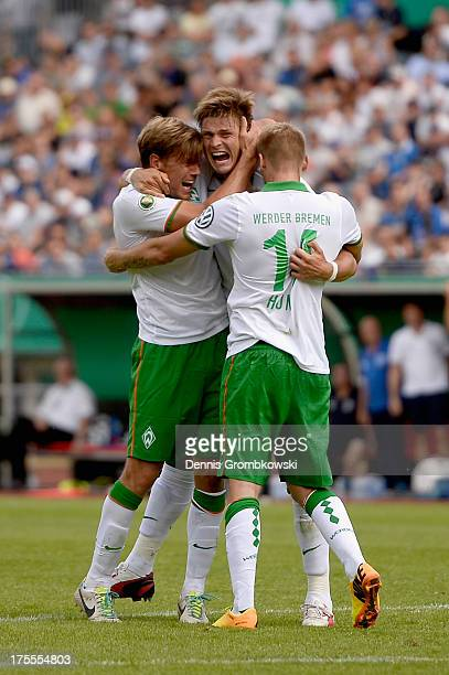 Sebastian Proedl of Werder Bremen celebrates with teammates after scoring his team's first goal during the DFB Cup first round match between 1 FC...