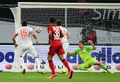 Sebastian Proedl of Werder Bremen shoots past Bernd Leno of Bayer Leverkusen to score their third goal during the Bundesliga match between Bayer 04...