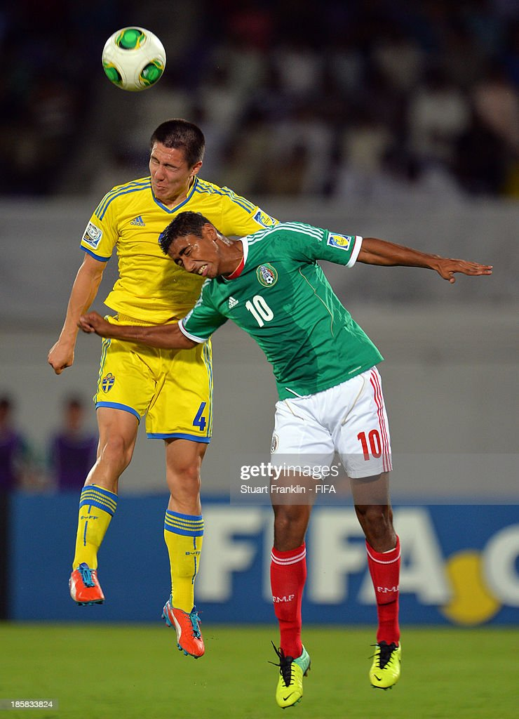 Sebastian Ramhorn of Sweden is challenged by Marco Granados of Mexico during the FIFA U 17 World Cup group F match between Sweden and Mexico at Khalifa Bin Zayed Stadium on October 25, 2013 in Al Ain, United Arab Emirates.