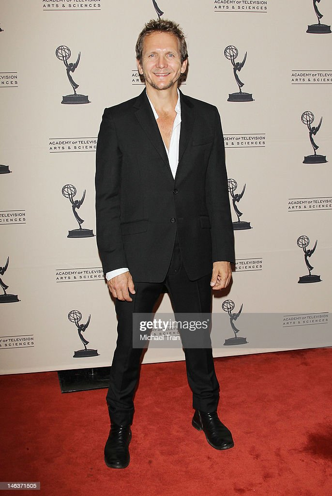 <a gi-track='captionPersonalityLinkClicked' href=/galleries/search?phrase=Sebastian+Roche&family=editorial&specificpeople=615770 ng-click='$event.stopPropagation()'>Sebastian Roche</a> arrives at 39th Daytime Entertainment Emmy Awards - nominees reception held at SLS Hotel on June 14, 2012 in Beverly Hills, California.