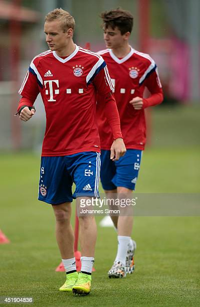 Sebastian Rode and Lucas Scholl of FC Bayern Muenchen attends a training session at Bayern`s trainings ground Saebener strasse on July 9 2014 in...