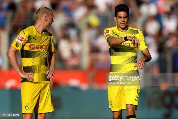 Sebastian Rode and Marc Bartra of Dortmund talk during the preseason friendly match between VfL Bochum and Borussia Dortmund at Vonovia Ruhrstadion...