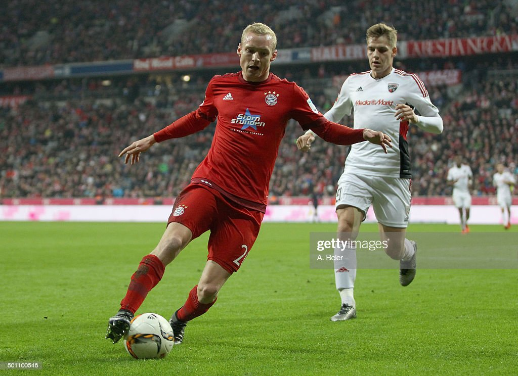 Sebastian Rode (L) of Bayern Muenchen plays the ball next to Max Christiansen of FC Ingolstadt during the Bundesliga match between FC Bayern Muenchen and FC Ingolstadt at Allianz Arena on December 12, 2015 in Munich, Germany.