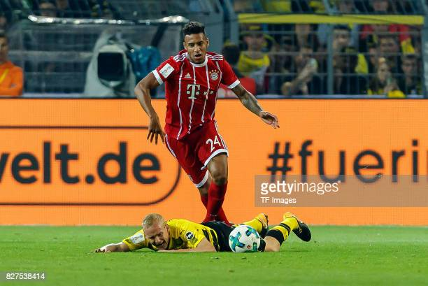 Sebastian Rode of Dortmund and Corentin Tolisso of Bayern Muenchen battle for the ball during the DFL Supercup 2017 match between Borussia Dortmund...
