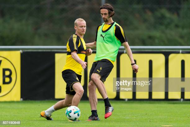 Sebastian Rode of Dortmund and Neven Subotic of Dortmund battle for the ball during a training session as part of the training camp on July 31 2017...
