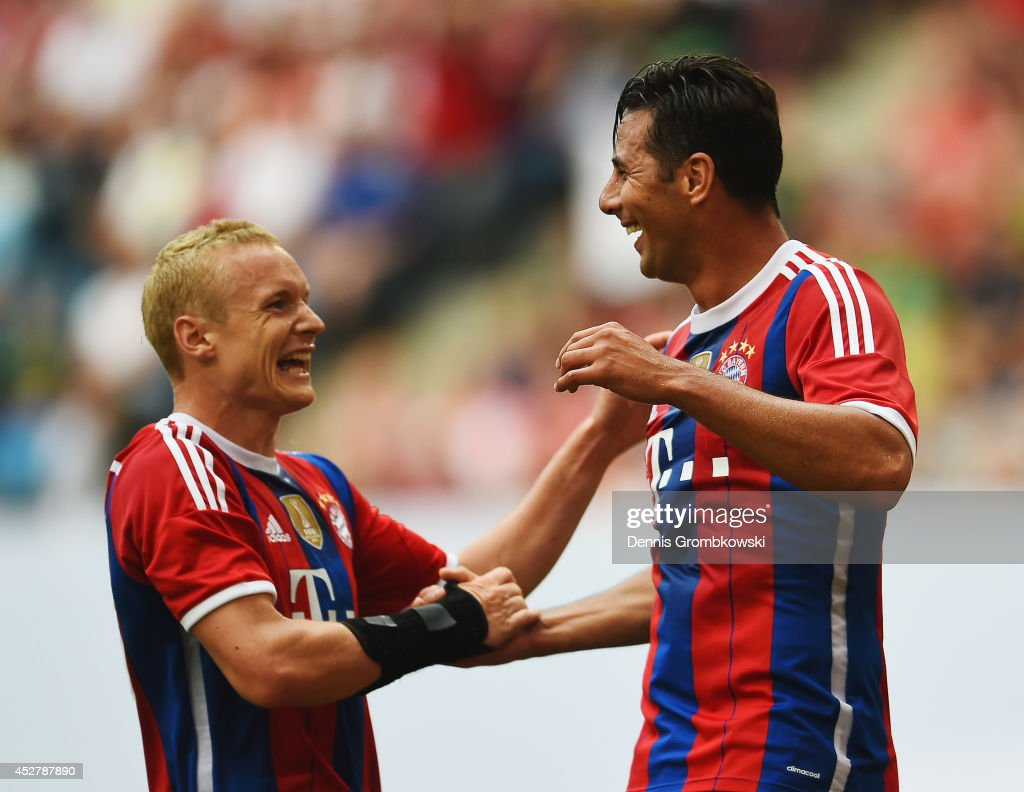 Sebastian Rode of FC Bayern Muenchen celebrates with team mate Claudio Pizarro after scoring his team's second goal during the Telekom Cup 2014 final...