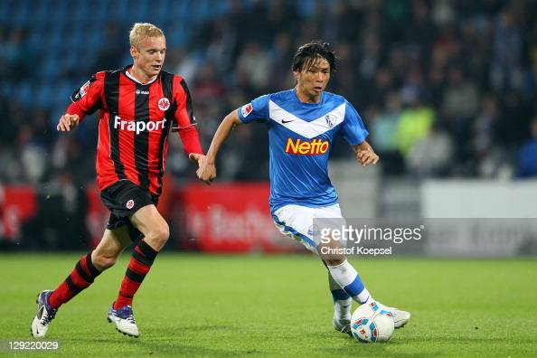 Sebastian Rode of Frankfurt challenges Takashi Inui of Bochum during the Second Bundesliga match between VfL Bochum and Eintracht Frankfurt at...